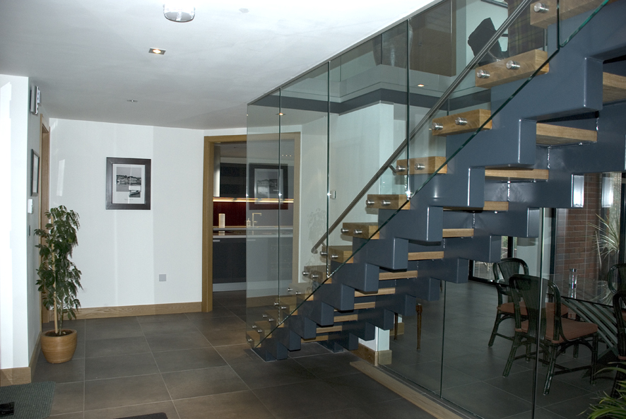Stainless steel and glass cantilevered staircase